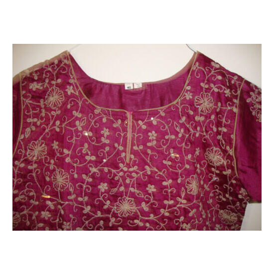 shalwar kameez brand new in burgundy.with all over work.